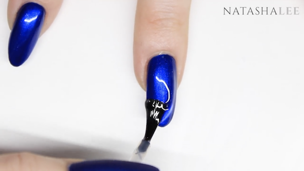 matte blue nails with crystals