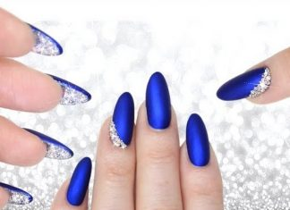 matte blue nails with crystals underneath